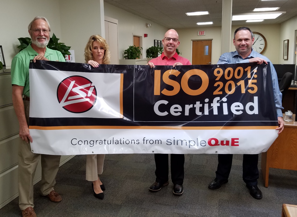 Photo from left to right:  Larry Vance, VP SimpleQuE; Yvette Kilburn, Corporate ISO Coordinator, LSI;  Shawn Toney, President of LSI Lighting;  Virgilio Acevedo, Corporate Director of Quality